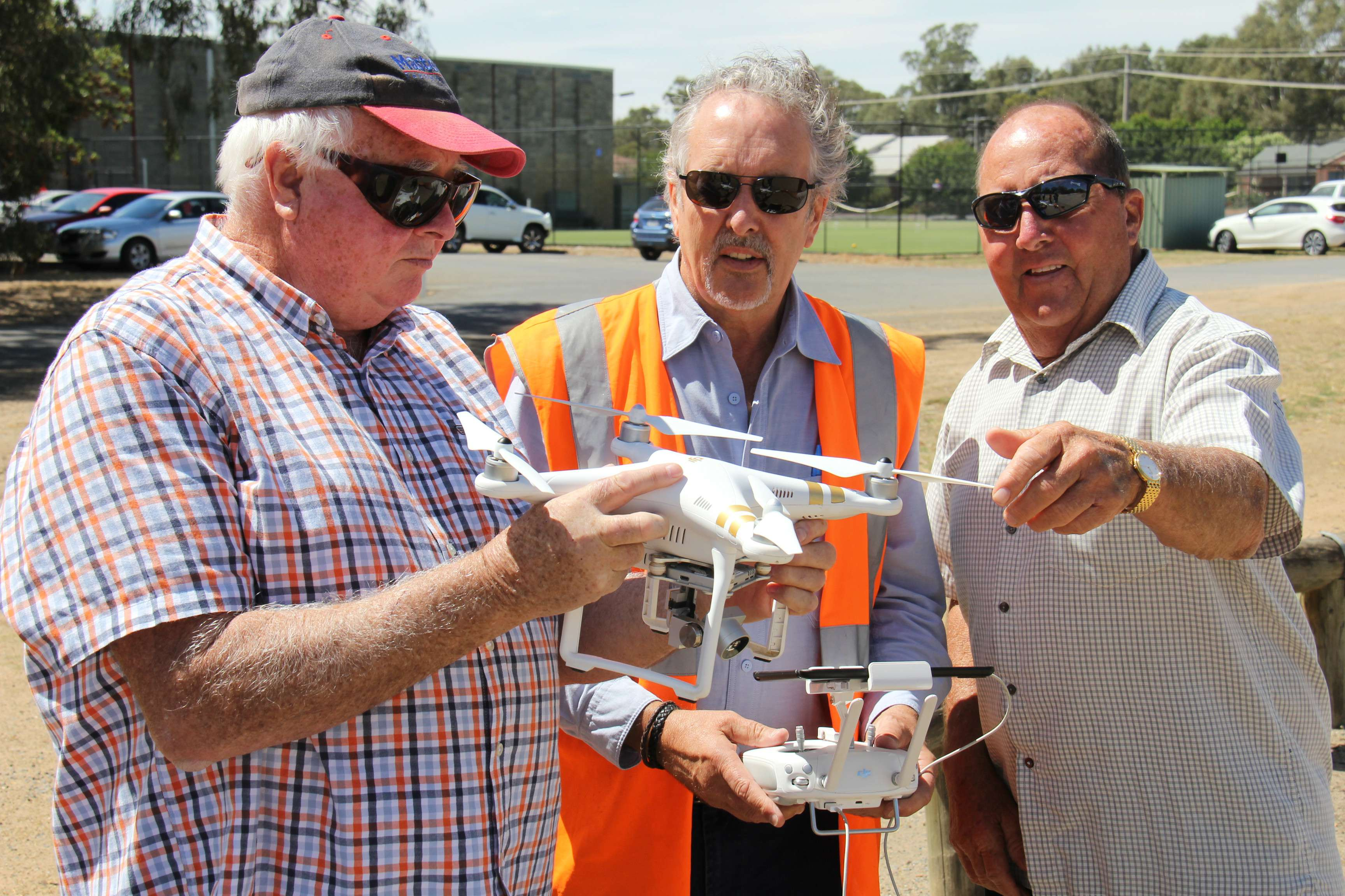 Retired Numurkah farmers John Blackman (left) and Ian Clark are pictured with GMW Draughting Officer and accredited drone pilot Graeme Eadie.