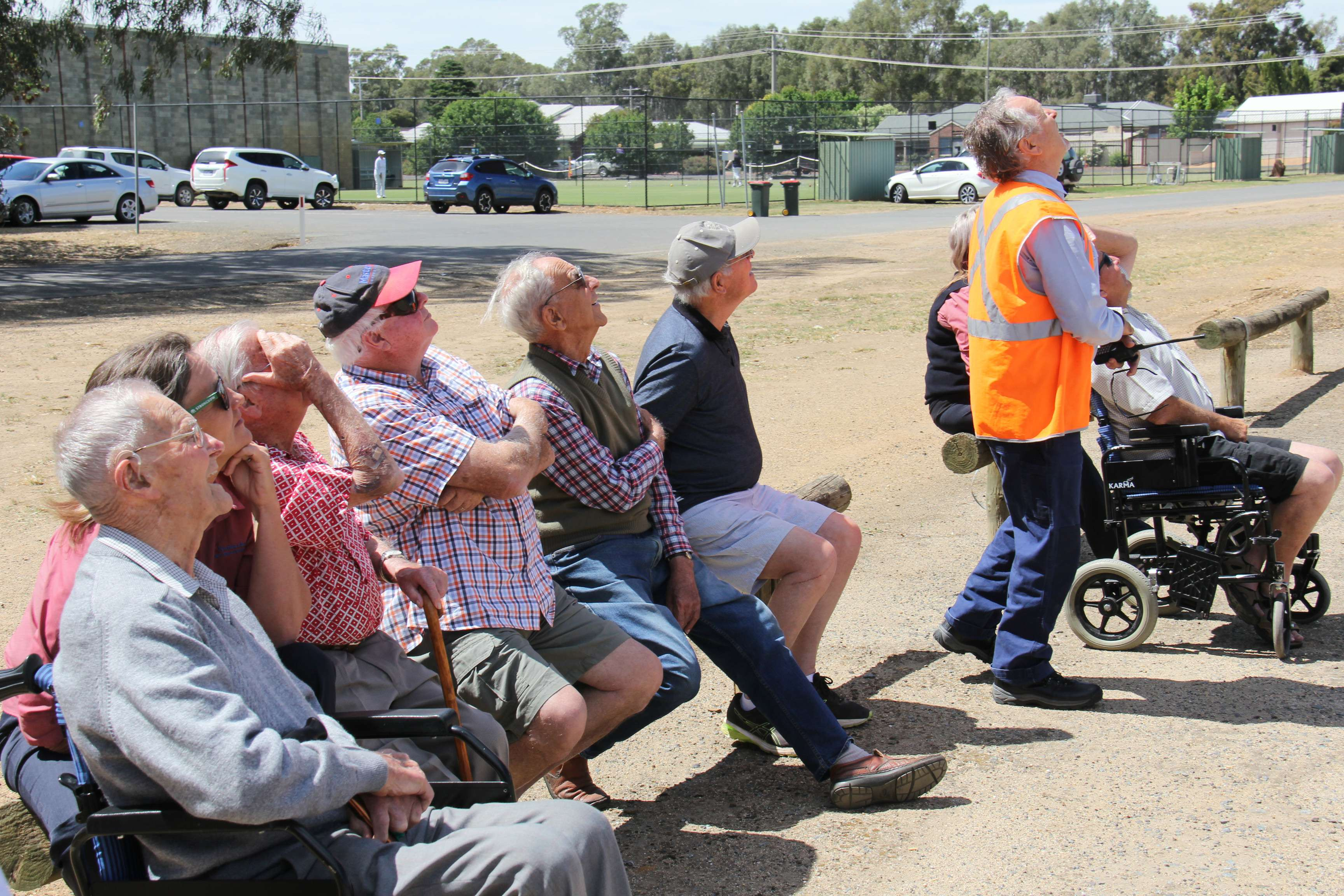 Members of the Numurkah Network watch the drone demonstration.